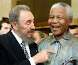 <p>Cuban leader Fidel Castro, left, shares a laugh with South Africa President Nelson Mandela at the World Trade Organization held in Geneva Tuesday, May 19, 1998. Mandela and Castro said in separate speeches that the global trading system had failed to achieve its goals of bringing a higher standard of living to many developing countries. (AP Photo/PATRICK AVIOLAT) </p>