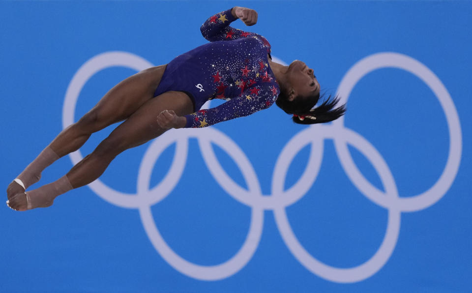 Simone Biles, of United States, performs her floor exercise routine during the women's artistic gymnastic qualifications at the 2020 Summer Olympics, Sunday, July 25, 2021, in Tokyo. (AP Photo/Gregory Bull)