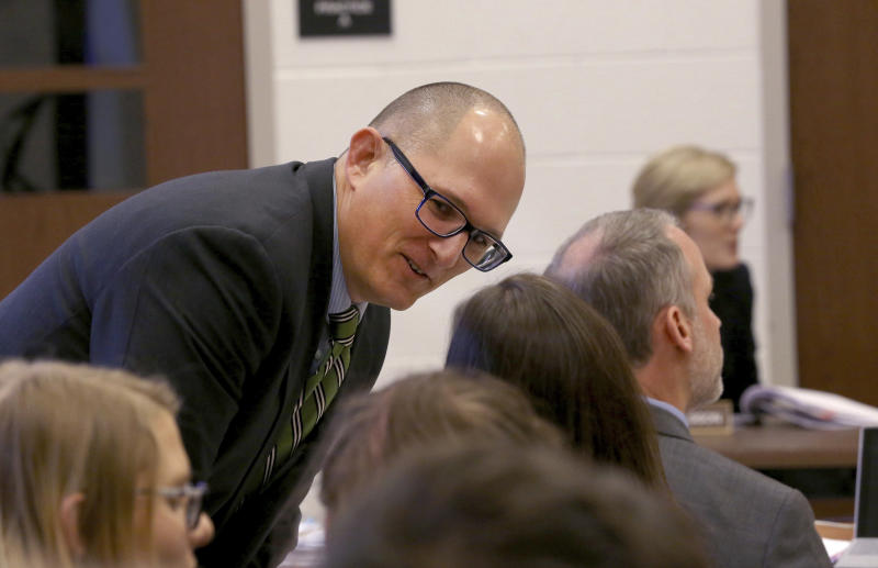 High school teacher Peter Vlaming chats at a West Point School Board hearing in West Point, Virginia on Dec. 6, 2018. | Shelby Lum—AP