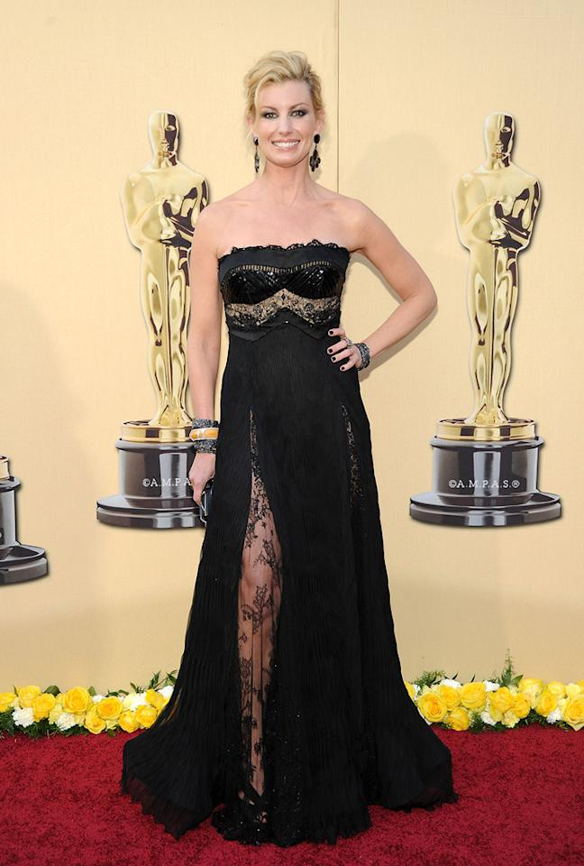 "Faith Hill   Grade: F    For some reason, the country songstress opted to go trashy goth for her walk down the Oscar red carpet with her hubby, ""The Blind Side"" star Tim McGraw. From the extreme lace-embellished slit to the patent-leather bustier, this outfit is a failure from head to toe!"