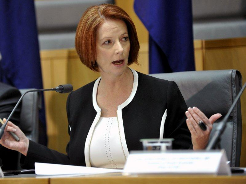 Gillard still welded to surplus promise
