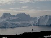 FILE PHOTO: A fishing vessel sails in the ice fjord near Ilulissat