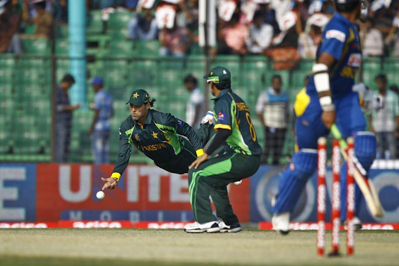 Pakistan's Anwar Ali, left, throws the ball as he fields during the opening match of the Asia Cup one-day international cricket tournament against Sri Lanka in Fatullah, near Dhaka, Bangladesh, Tuesday, Feb. 25, 2014. (AP Photo/A.M. Ahad)