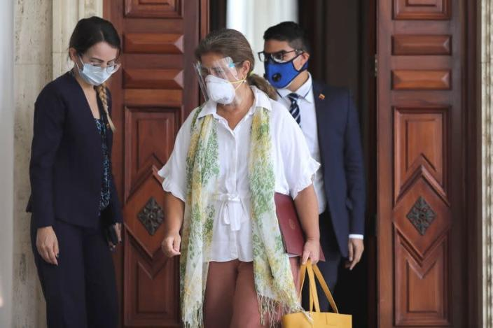 The ambassador of the European Union to Venezuela, Isabel Brilhante Pedrosa, leaves after a meeting at the Foreign Ministry headquarters in Caracas