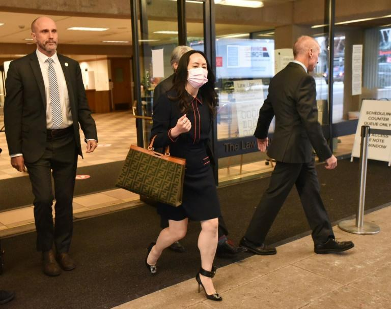 Huawei Chief Financial Officer Meng Wanzhou leaves the British Columbia Supreme Court in Vancouver after a second day of testimony by the arresting officer at her extradition hearing