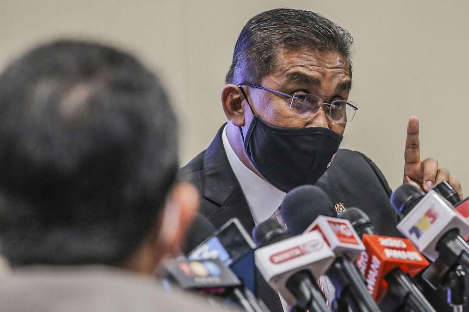 Datuk Seri Takiyuddin Hassan speaks during a press conference in Putrajaya March 12, 2021. — Picture by Hari Anggara