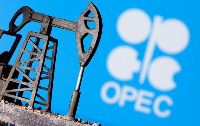 FILE PHOTO: A 3D printed oil pump jack is seen in front of displayed Opec logo in this illustration picture