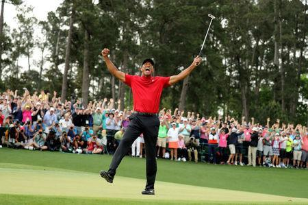 Golf - Masters - Augusta National Golf Club - Augusta, Georgia, U.S. - April 14, 2019 - Tiger Woods of the U.S. celebrates on the 18th hole after winning the 2019 Masters. REUTERS/Lucy Nicholson