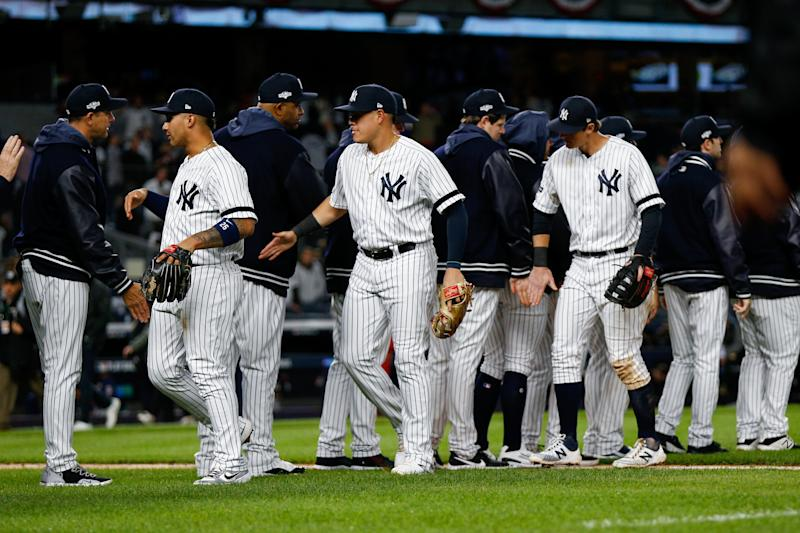 Oct 5, 2019; Bronx, NY, USA; The New York Yankees celebrate defeating the Minnesota Twins after game two of the 2019 ALDS playoff baseball series at Yankee Stadium. Mandatory Credit: Andy Marlin-USA TODAY Sports