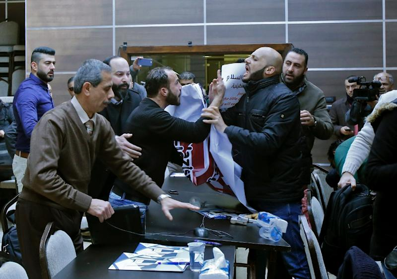Palestinian activists disrupt a meeting attended by members of an American economic delegation in Bethlehem on January 30, 2018 (AFP Photo/Musa AL SHAER)