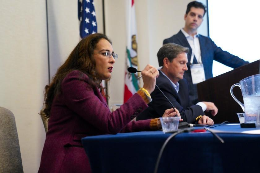 """San Diego, CA - September 25: At the California Republicans Convention on Saturday, Sept. 25, 2021 in San Diego, CA., Harmeet Dhillon answered audience questions from attendees during the panel discussion for """"The National Debate over election integrity laws"""". Also on the panel were Fred Whitaker (seated) and Garrett Fahy (standing). (Nelvin C. Cepeda / The San Diego Union-Tribune)"""