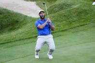Team Europe's Jon Rahm reawcts to a mkissed putt on the 18th hole during a four-ball match the Ryder Cup at the Whistling Straits Golf Course Friday, Sept. 24, 2021, in Sheboygan, Wis. (AP Photo/Ashley Landis)