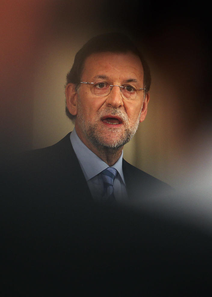 Spain's Prime Minister Mariano Rajoy speaks during a press conference at the Moncloa Palace, in Madrid, Sunday, June 10, 2012. Spain became the fourth and largest country to ask Europe to rescue its failing banks, a bailout of up to euro 100 billion ($125 billion) that leaders hoped would stabilize a financial crisis that threatens to break apart the 17-country eurozone. (AP Photo/Andres Kudacki)