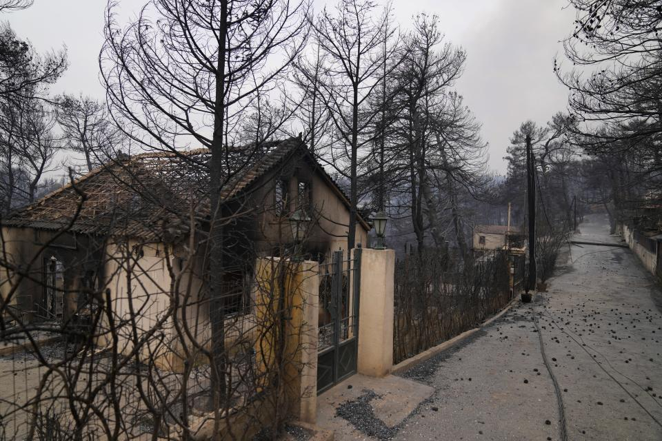 A burnt house after a wildfire in Drosopigi village, about 28 kilometres (27 miles) north of Athens, Greece, Friday, Aug. 6, 2021. Thousands of residents of the Greek capital have fled to safety from a wildfire that burned for a fourth day north of Athens as crews battle to stop the flames reaching populated areas, electricity installations and historic sites. (AP Photo/Thanassis Stavrakis)