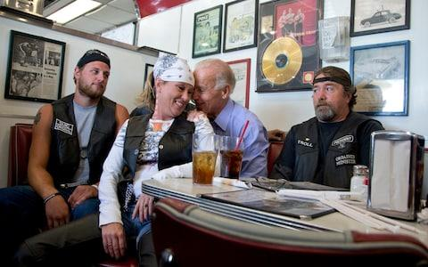 Joe Biden's talks to customers during a stop at Cruisers Diner in Seaman, Ohio, in 2012 - Credit: AP
