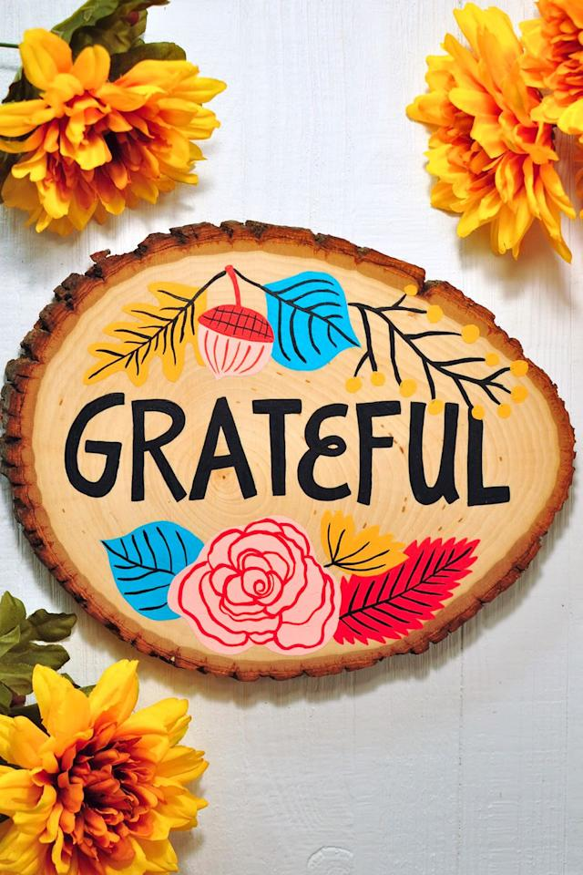 "<p>$55 and up</p><p><a rel=""nofollow"" href=""https://www.etsy.com/listing/639915099/grateful-sign-thanksgiving-decorations"">BUY NOW</a></p><p>This cheery, vibrant design will set the tone for guests as they arrive at your home for the holiday.</p>"
