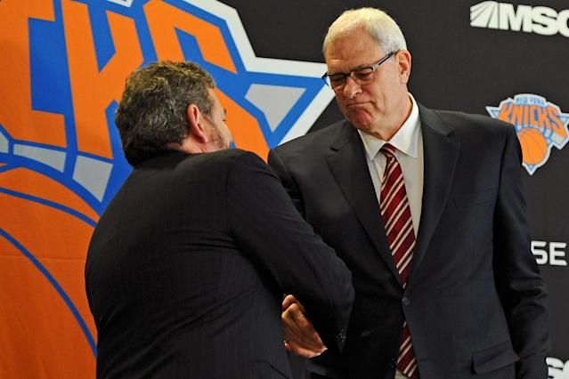 NEW YORK, NY - MARCH 18: Phil Jackson shakes hands with James Dolan, Executive Chairman of Maidson Square Garden, during his introductory press conference as President of the New York Knicks at Madison Square Garden on March 18, 2014 in New York City. (Photo by Maddie Meyer/Getty Images)