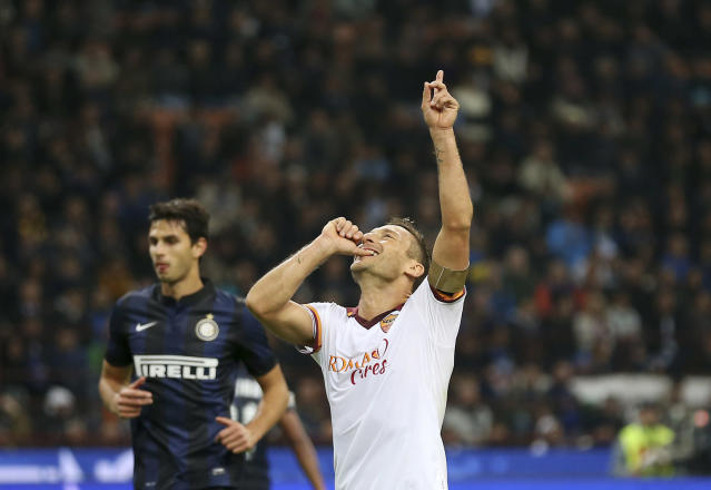 AS Roma forward Francesco Totti celebrates after scoring during the Serie A soccer match between Inter Milan and Roma at the San Siro stadium in Milan, Italy, Saturday, Oct. 5, 2013. (AP Photo/Antonio Calanni)