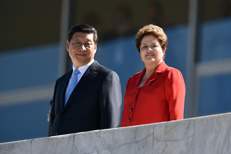 China's President Xi Jinping (L) is welcomed by his Brazilian counterpart Dilma Rousseff at Planalto Palace on July 17, 2014 in Brasilia