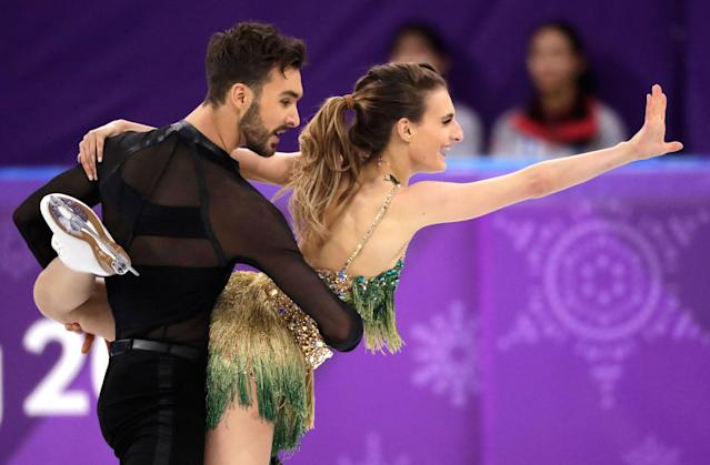 <p>Gabriella Papadakis and Guillaume Cizeron of France perform during the ice dance, short dance figure skating in the Gangneung Ice Arena at the 2018 Winter Olympics in Gangneung, South Korea, Monday, Feb. 19, 2018. (AP Photo/Bernat Armangue) </p>