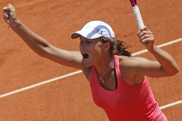 Varvara Lepchenko of the U.S. celebrates winning her third round match against Francesca Schiavone of Italy at the French Open tennis tournament in Roland Garros stadium in Paris, Saturday June 2, 2012. Lepchenko won in three sets 3-6, 6-3, 8-6. (AP Photo/Michel Euler)