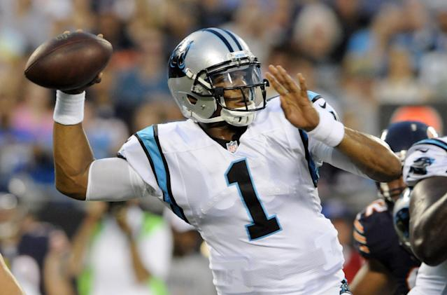 Carolina Panthers quarterback Cam Newton (1) looks to pass against the Chicago Bears during the first half of a preseason NFL football game in Charlotte, N.C., Friday, Aug. 9, 2013. (AP Photo/Mike McCarn)