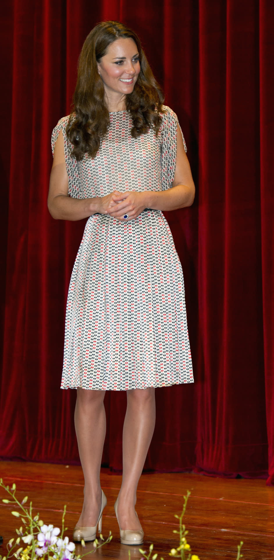 <p>The Duchess spent a day in Singapore in a printed top and pleated skirt by Raoul. She finished with nude L.K. Bennett heels. </p><p><i>[Photo: PA]</i></p>
