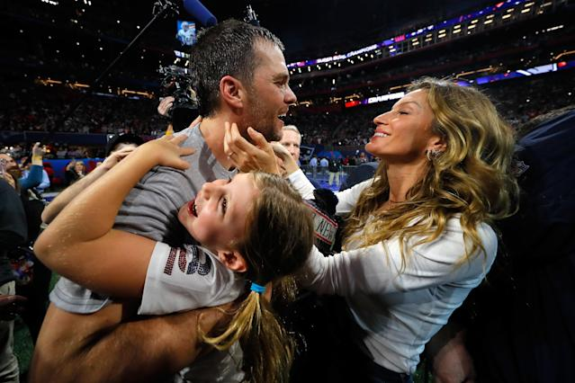 Tom Brady and Gisele Bundchen have plenty of reasons to smile. (Getty)