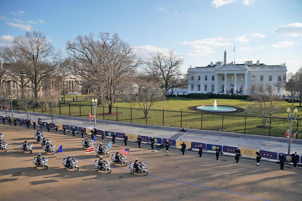 <p>Members of the D.C.'s Metropolitan Police Department ride by the White House on motorcycles during the 59th presidential inauguration parade on Jan. 20.</p>