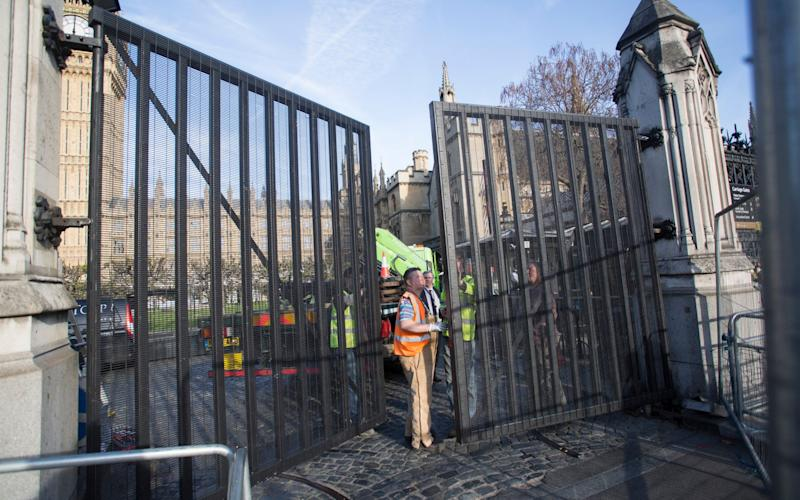 New Gates are installed at the Palace of Westminster in central London today - Credit: Nick Edwards
