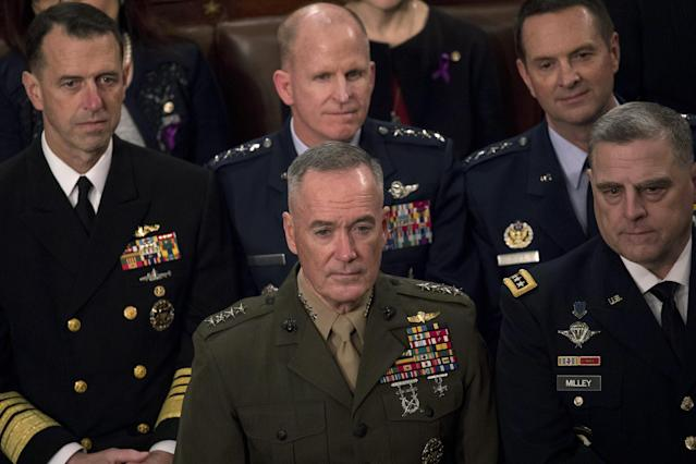 <p>Gen. Joseph Dunford, chairman of the Joint Chiefs of Staff, bottom center, and fellow military leaders during the State of the Union address on Jan. 30. (Photo: Aaron P. Bernstein/Bloomberg via Getty Images) </p>