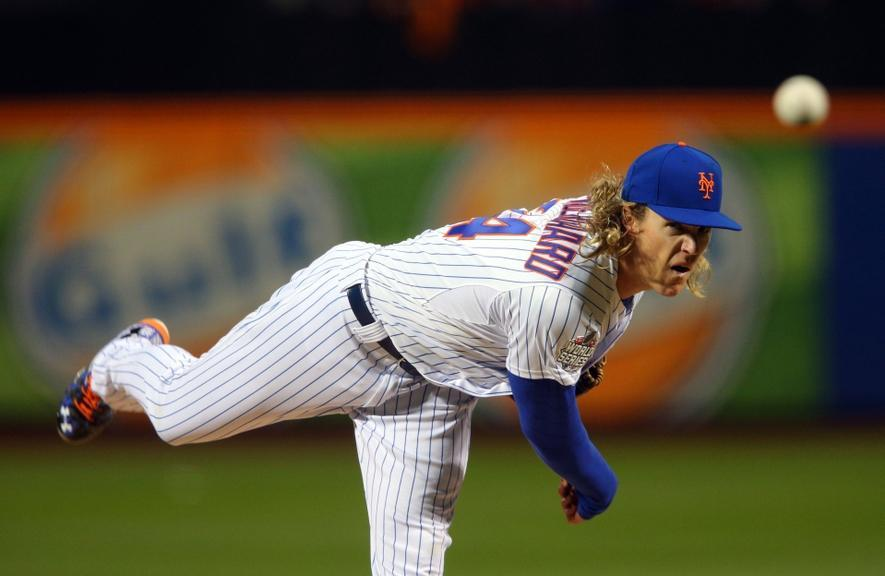 Oct 30, 2015; New York City, NY, USA; New York Mets starting pitcher Noah Syndergaard throws a pitch against the Kansas City Royals in the first inning in game three of the World Series at Citi Field.