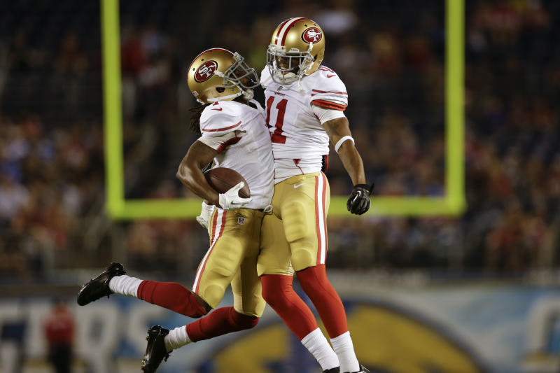 San Francisco 49ers wide receiver Chuck Jacobs, left, celebrates with teammate wide receiver Quinton Patton after Jacobs scored a touchdown against the San Diego Chargers during the second half of an NFL preseason football game, Thursday, Aug. 29, 2013, in San Diego. (AP Photo/Lenny Ignelzi)