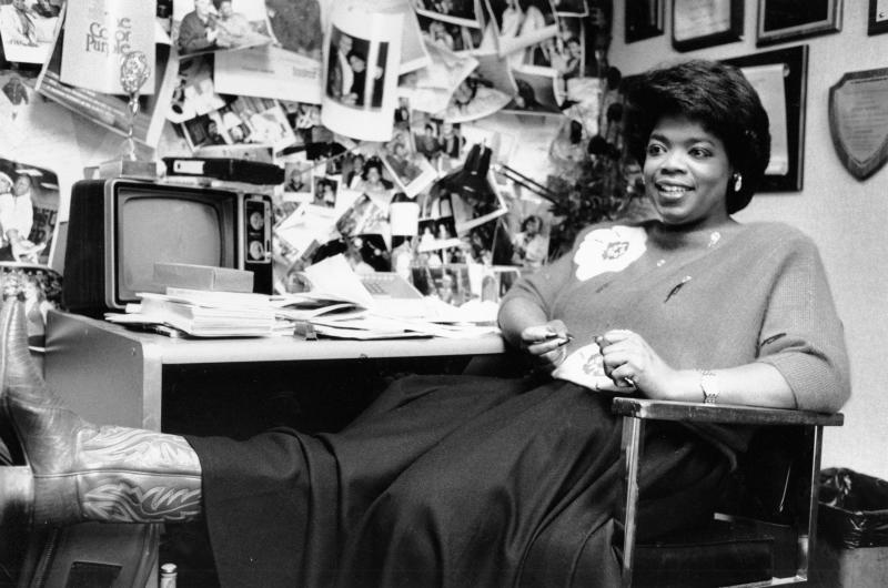 "FILE - In this Dec. 18, 1985 file photo, television talk-show host Oprah Winfrey puts her feet up as she relaxes in her studio office following a morning broadcast in Chicago, Ill. Winfrey came to Chicago in 1984 to WLS-TV's morning talk show, ""A.M. Chicago."" A month later the show was No. 1 in the market. A year later it was renamed ""The Oprah Winfrey Show."" Winfrey's talk show, which has taped in Chicago for 25 years, ends May 25, 2011. (AP Photo/Charlie Knoblock, File)"