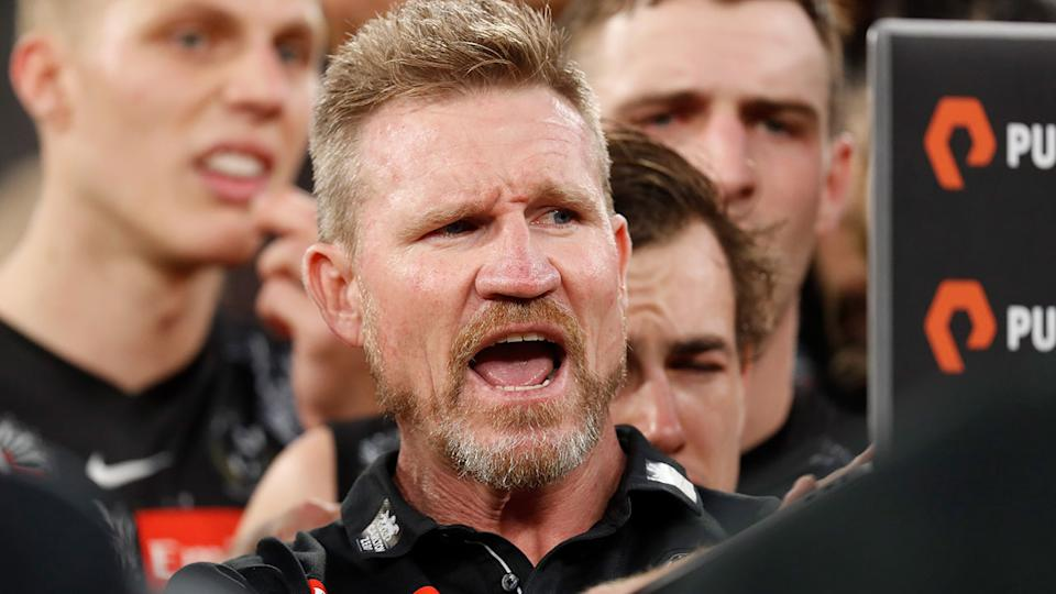 Pictured here, Collingwood Nathan Buckley gives a passionate address to his players.