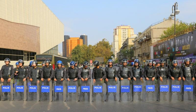 Azerbaijani law enforcement officers stand guard during an opposition rally in Baku