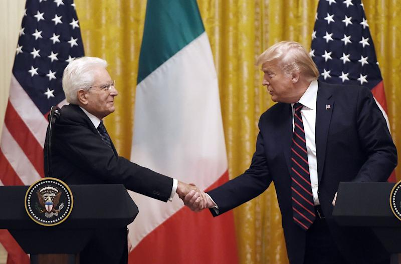 US President Donald Trump and Italian President Sergio Mattarella shake hands (AFP via Getty Images)