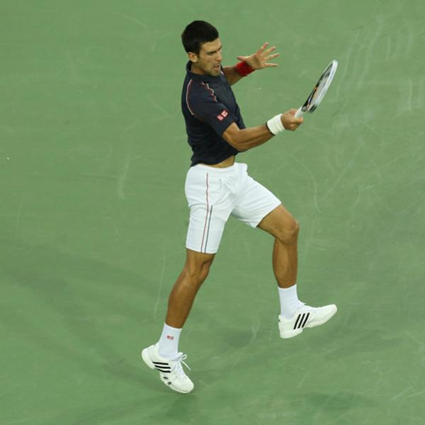 MASON, OH - AUGUST 16: Novak Djokovic of Serbia hits a forehand against Nikolay Davydenko of Russia during day six of the Western & Southern Open at Lindner Family Tennis Center on August 16, 2012 in Mason, Ohio.  (Photo by Nick Laham/Getty Images)