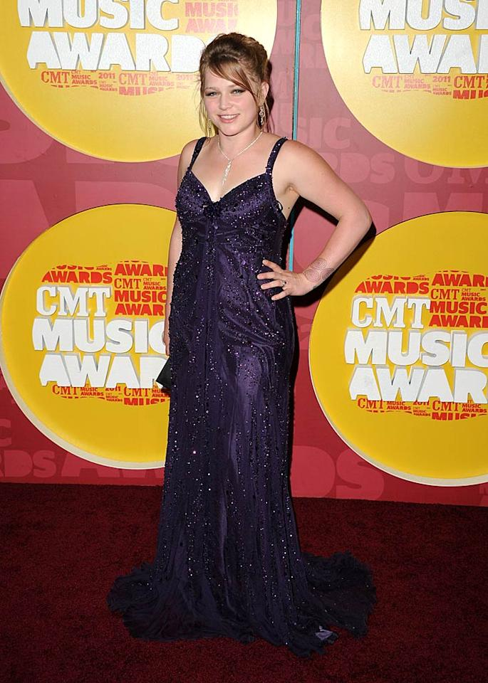 """""""American Idol"""" alum Crystal Bowersox popped a pose in a purple prom bomb and messy mane. Jason Merritt/<a href=""""http://www.gettyimages.com/"""" target=""""new"""">GettyImages.com</a> - June 8, 2011"""