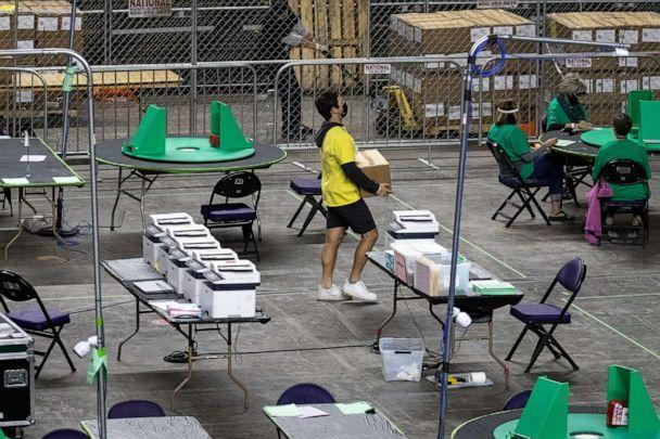PHOTO: A box of Maricopa County ballots cast in the 2020 general election are delivered to be examined and recounted by contractors hired by the Arizona Senate, June 1, 2021, at the Veterans Memorial Coliseum, in Phoenix. (Mark Henle/The Republic/Imagn/USA Today Network, FILE)