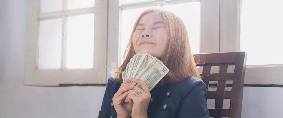Women with money, compensation, reward of good people, annual bonuses, the trend of earning money as compensation.