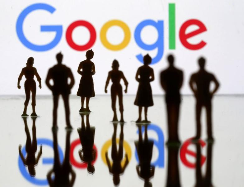 FILE PHOTO: Small toy figures are seen in front of Google logo in this illustration picture