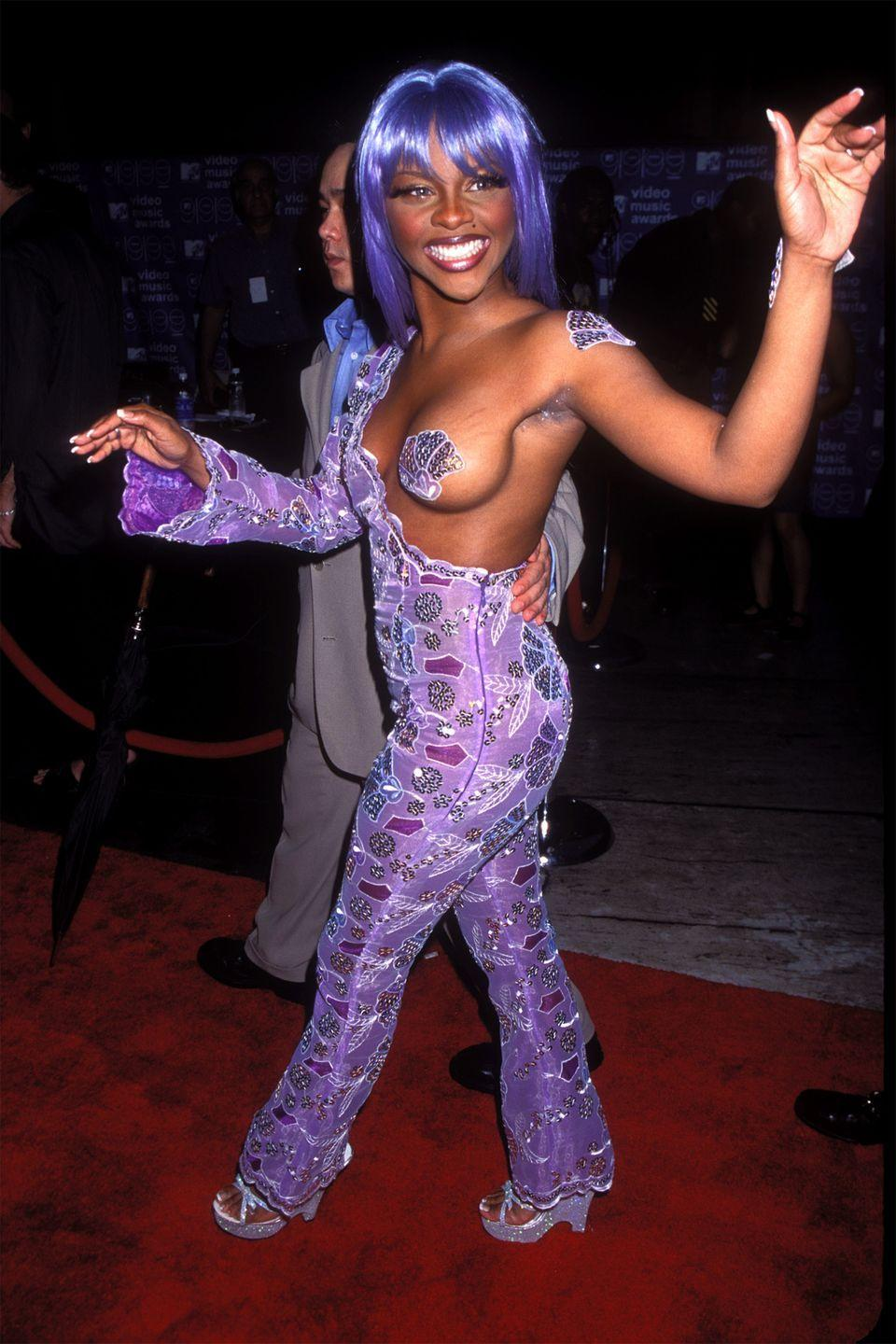 "<p>In an unforgettable red carpet moment, Lil' Kim arrived to the 1999 <a href=""https://www.huffingtonpost.com/2013/07/11/lil-kim-purple-pasty-photos_n_3574366.html"" rel=""nofollow noopener"" target=""_blank"" data-ylk=""slk:MTV Video Music Awards"" class=""link rapid-noclick-resp"">MTV Video Music Awards</a> wearing a mermaid-inspired jumpsuit, complete with a sequin shell pasty. The boob-baring accessory went down in history, and Miley Cyrus even <a href=""https://people.com/celebrity/miley-cyrus-dresses-as-lil-kim-for-halloween/"" rel=""nofollow noopener"" target=""_blank"" data-ylk=""slk:recreated"" class=""link rapid-noclick-resp"">recreated</a> the look for Halloween. </p>"