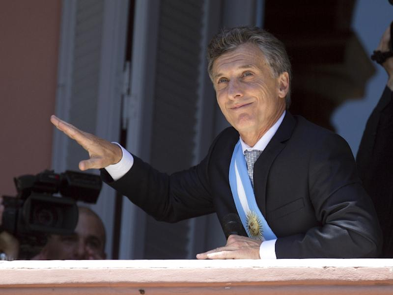 Argentina's President Mauricio Macri dances on a balcony of the Casa Rosada after the inauguration ceremony in Buenos Aires on December 10, 2015