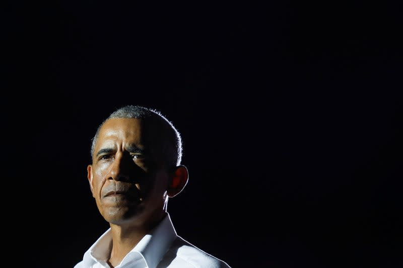 Former U.S. President Barack Obama looks on during a drive-in campaign rally on behalf of Democratic presidential nominee and former Vice President Joe Biden in Miami