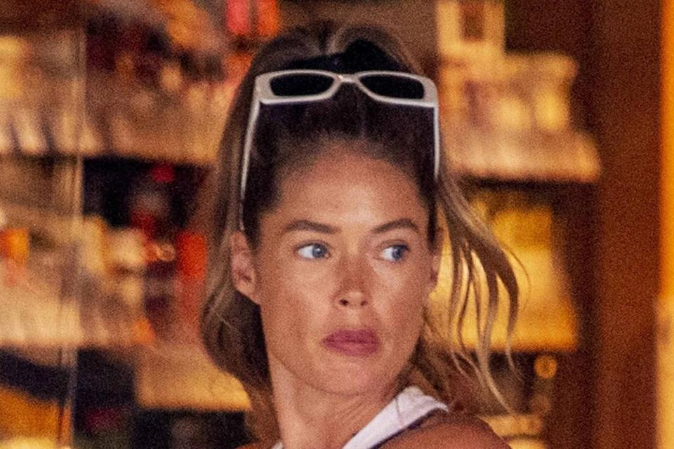 Doutzen Kroes Wears the Shirt of the Summer With Denim Cutoffs & the Chunkiest Sneakers