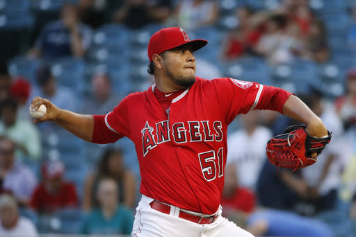 Los Angeles Angels starting pitcher Jaime Barria throws against the Seattle Mariners during the first inning of a baseball game Wednesday, July 11, 2018, in Anaheim, Calif. (AP Photo/Jae C. Hong)