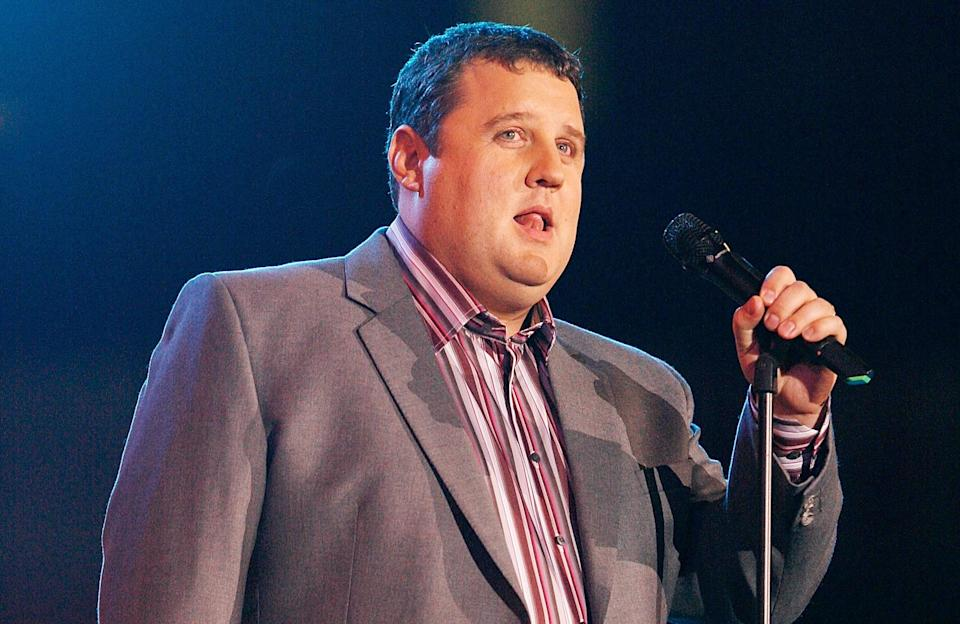 Peter Kay comedian introduces Robbie Williams on stage at the Help for Heroes Concert at Twickenham Stadium in 2010. (PA)