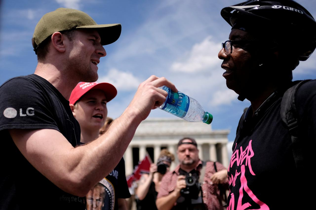 "Don Folden, the founder of an African-American history tour company (R) argues with a man named Justin from western New York state during a demonstration organized by self-proclaimed White Nationalists and members of the ""Alt-Right"" which they described as a ""Freedom of Speech"" rally at the Lincoln Memorial in Washington, U.S. June 25, 2017. REUTERS/James Lawler Duggan"
