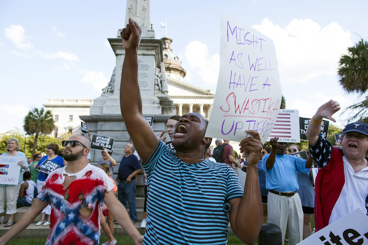 Nathan Brown yells for the removal of the confederate battle flag that flies at the South Carolina State House in Columbia, SC June 20, 2015.  REUTERS/Jason Miczek